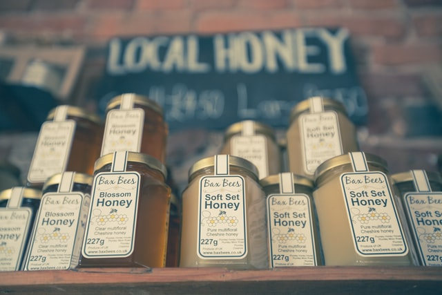 Local honey pots on shelve