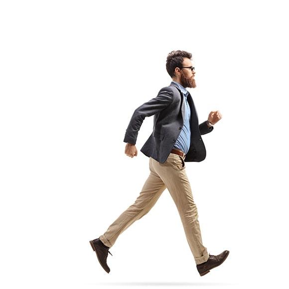 Man walking towards cargo shipment